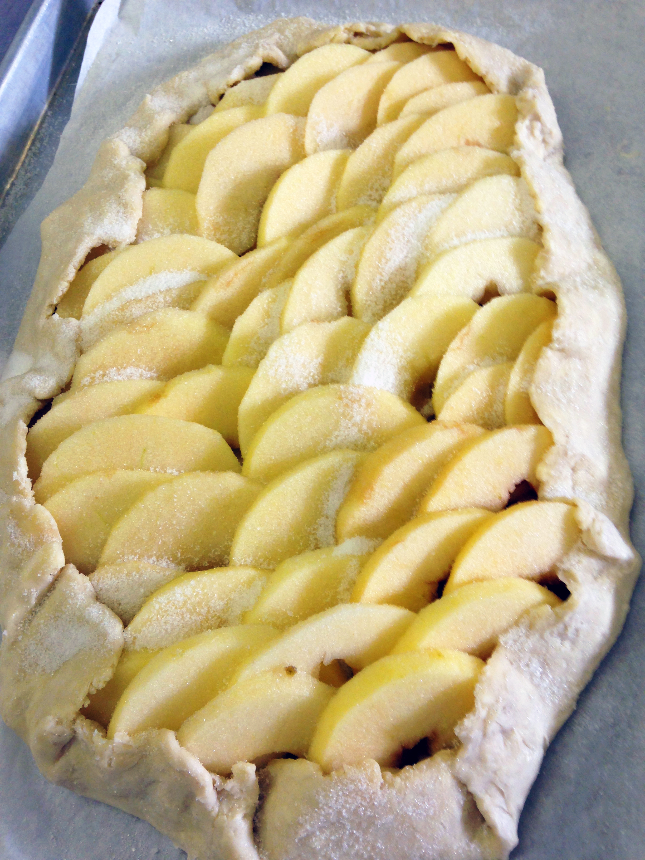 After this apple tart was baked, it was glazed with apricot jam and calvados
