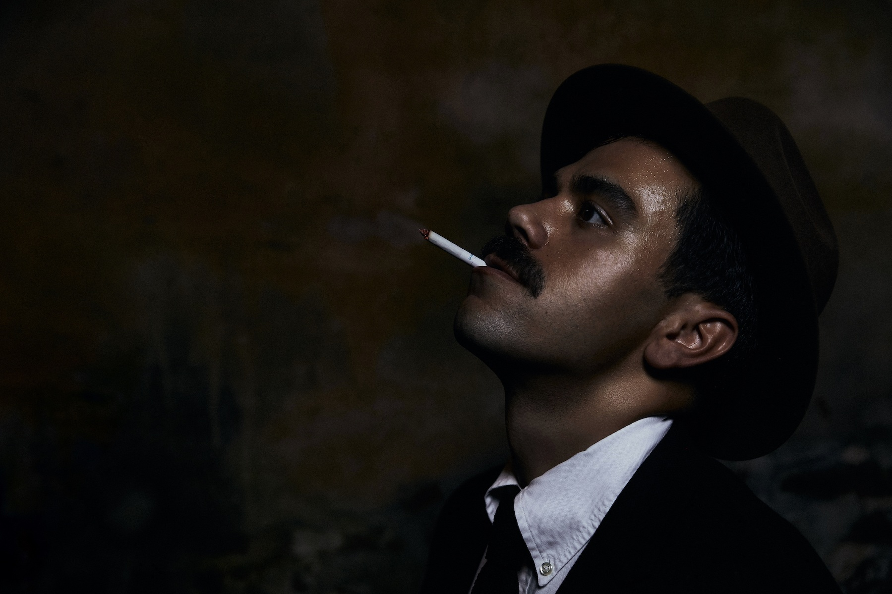 KRC Man Smoking with Hat.jpg