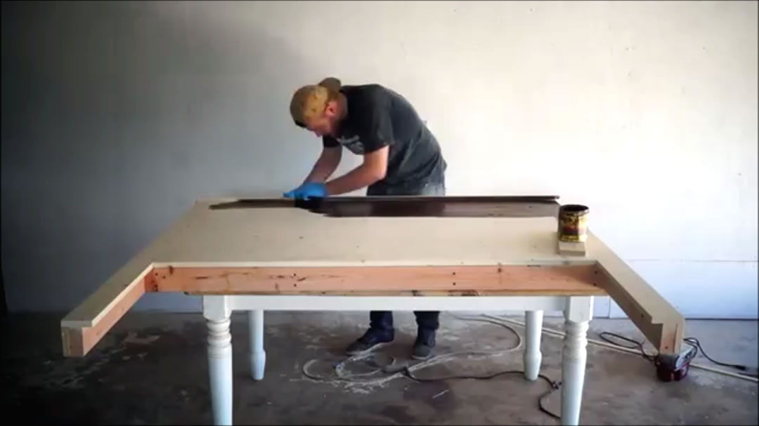applying the finishing touches to headboard