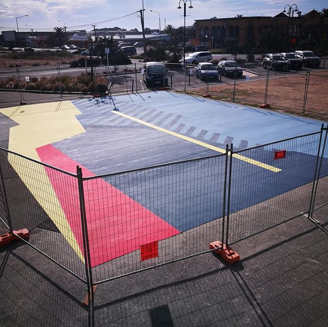 It's all go in New Brighton as the Re:ACTIVATE project draws closer to completion. From our open call, run conjunction with Development Christchurch Limited, there were numerous high quality entries received. The winning artists are both New Brighton locals: Nathan Ingram (aka Dr Suits) with his work FORCES is pictured here being produced on a basketball court surface. This joins Josh O'Rourke's design Low Pressure High Pressure which fills a large mural wall space overlooking the basketball court.  #scapeart #newbrighton #basketball #developmentchristchurchltd 📷 #reubensoods