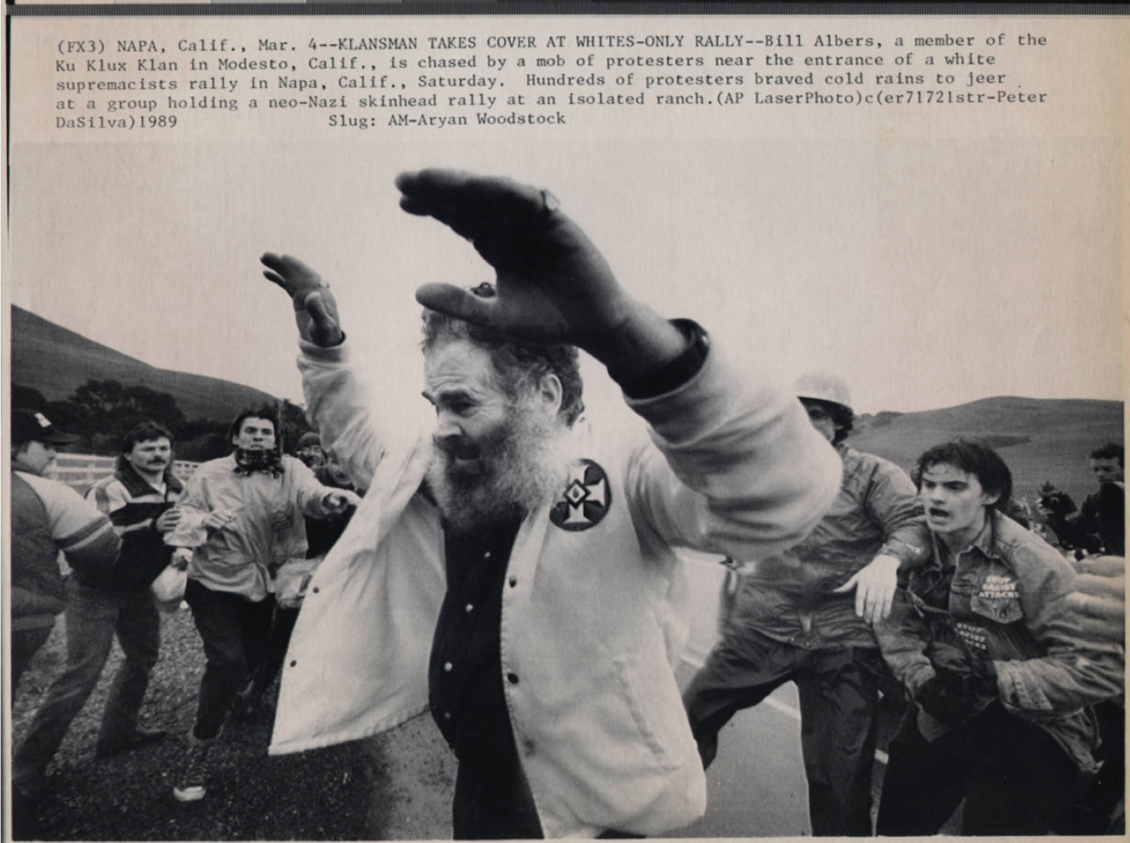 Bill Albers, a member of the Ku Klux Klan being chased by a mob of protesters. AP/Peter DaSilva
