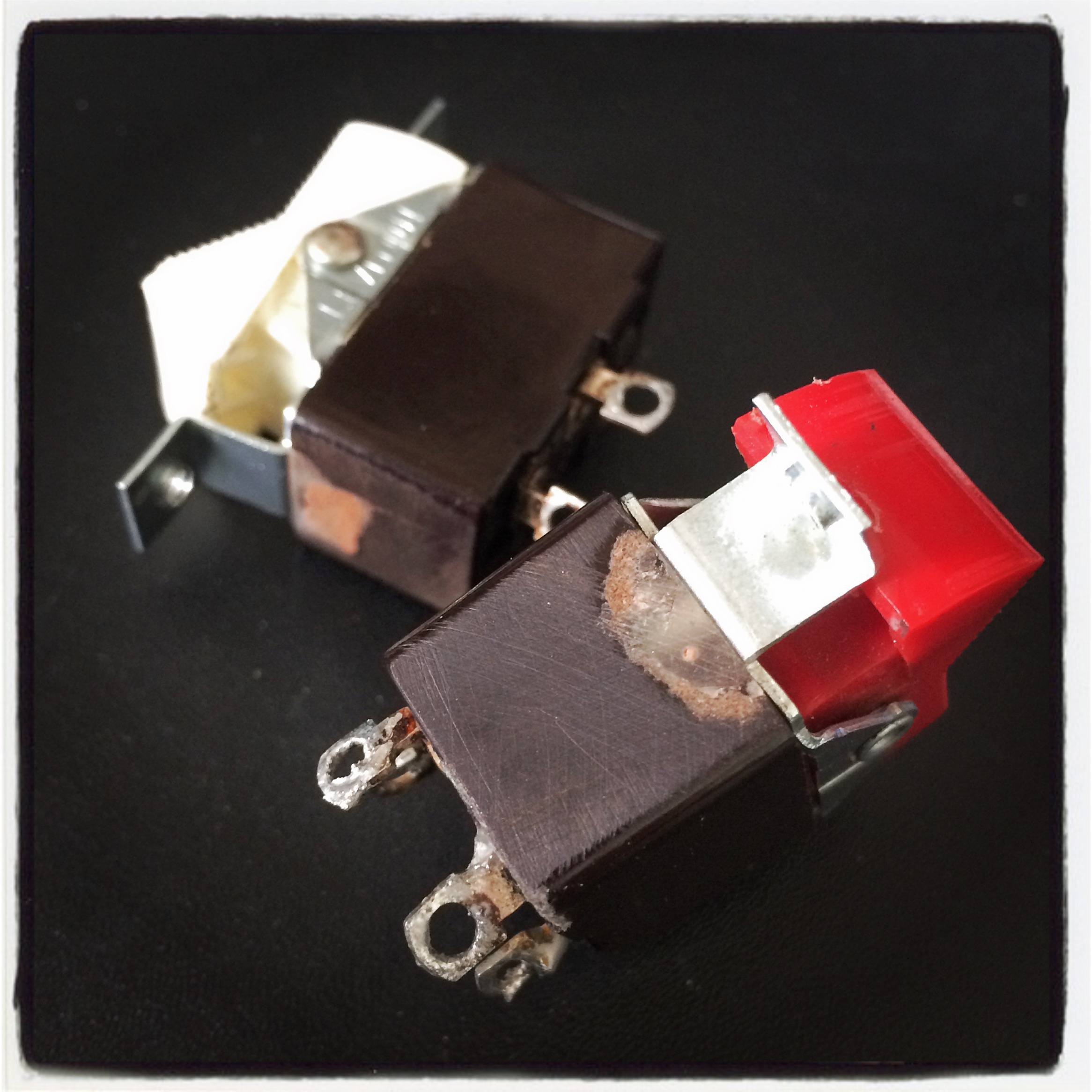 Rocker switches repaired with epoxy and machine screws, replacing broken Bakelite and rivets.