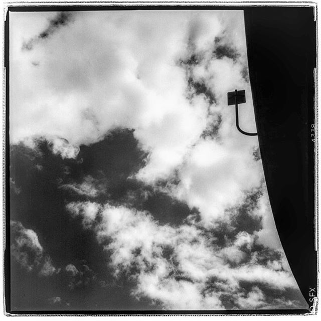 "LIFE SQUARED - ""cloudy direction"" © 2018 Peter DaSilva. #freeway #signpole #overhead #roadway #120 #ilford #SFX #bw #film #fullframe #rolleiflex #f4tele #filmisnotdead #ilfordphoto #filmlover #6x6 #analog #nophotoshop #filmphotographer #pdsphoto #peterdasilva #rolleiclub #analogueposse"