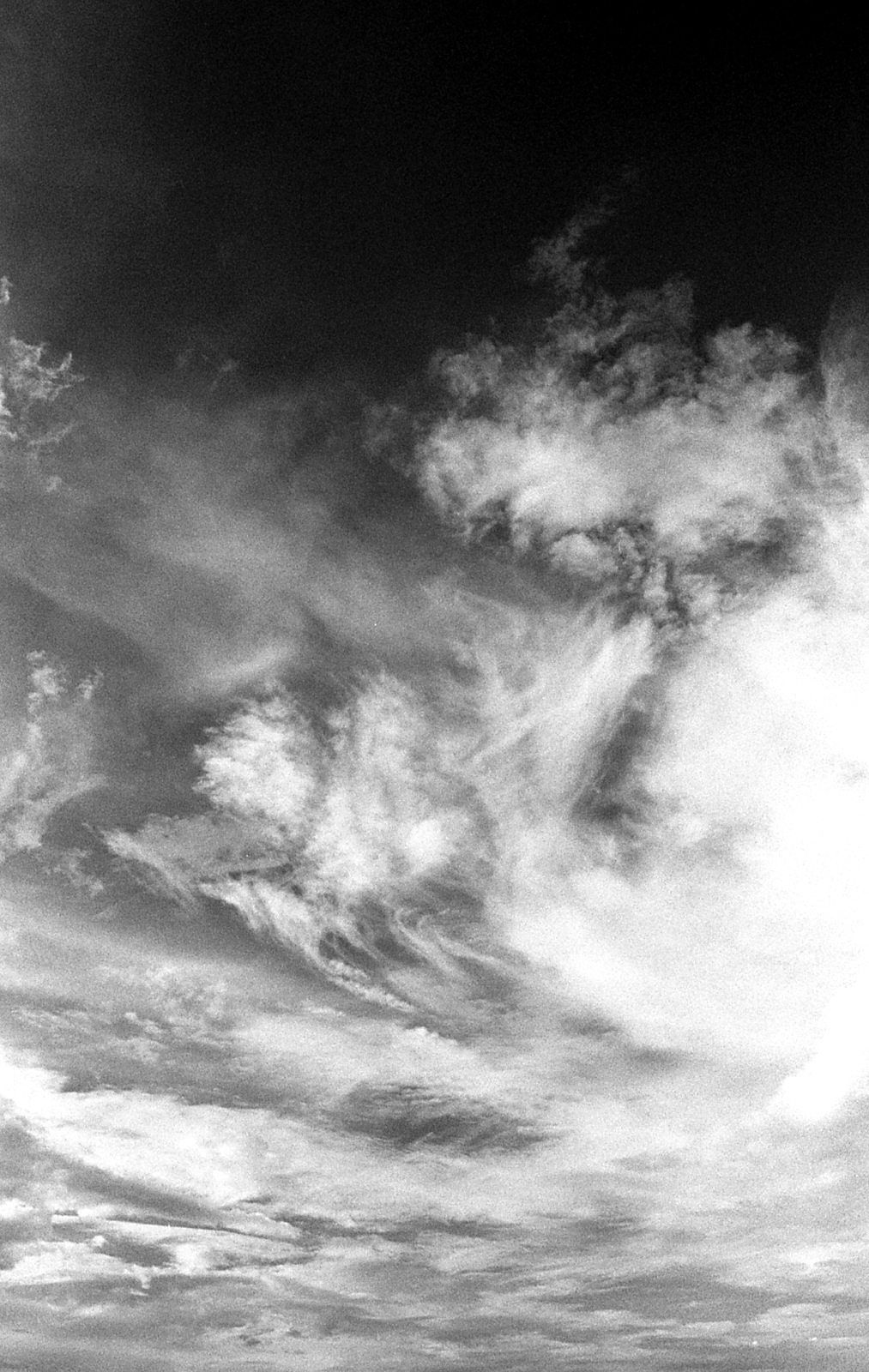 Clouds. Taken on Ilford HP5 Plus 35mm film with a Nikon N75
