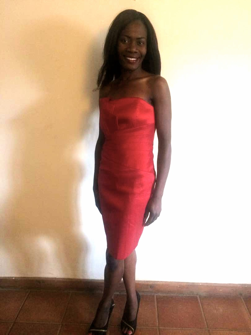 The Dress Project volunteer/model proves this dress is still on fire!
