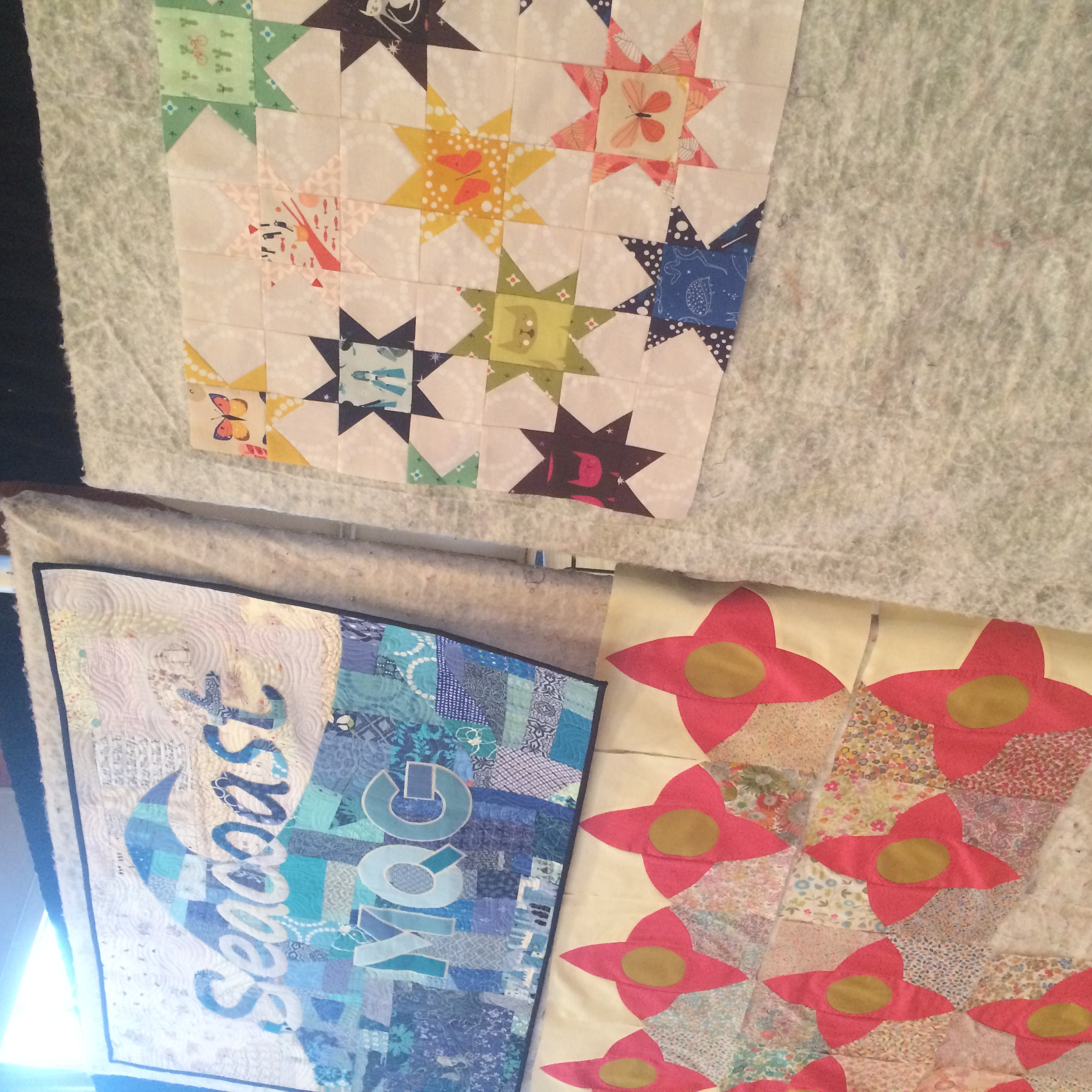 Our guild banner,  Laura's  Meadow Quilt, and my Lizzy House Swap mini