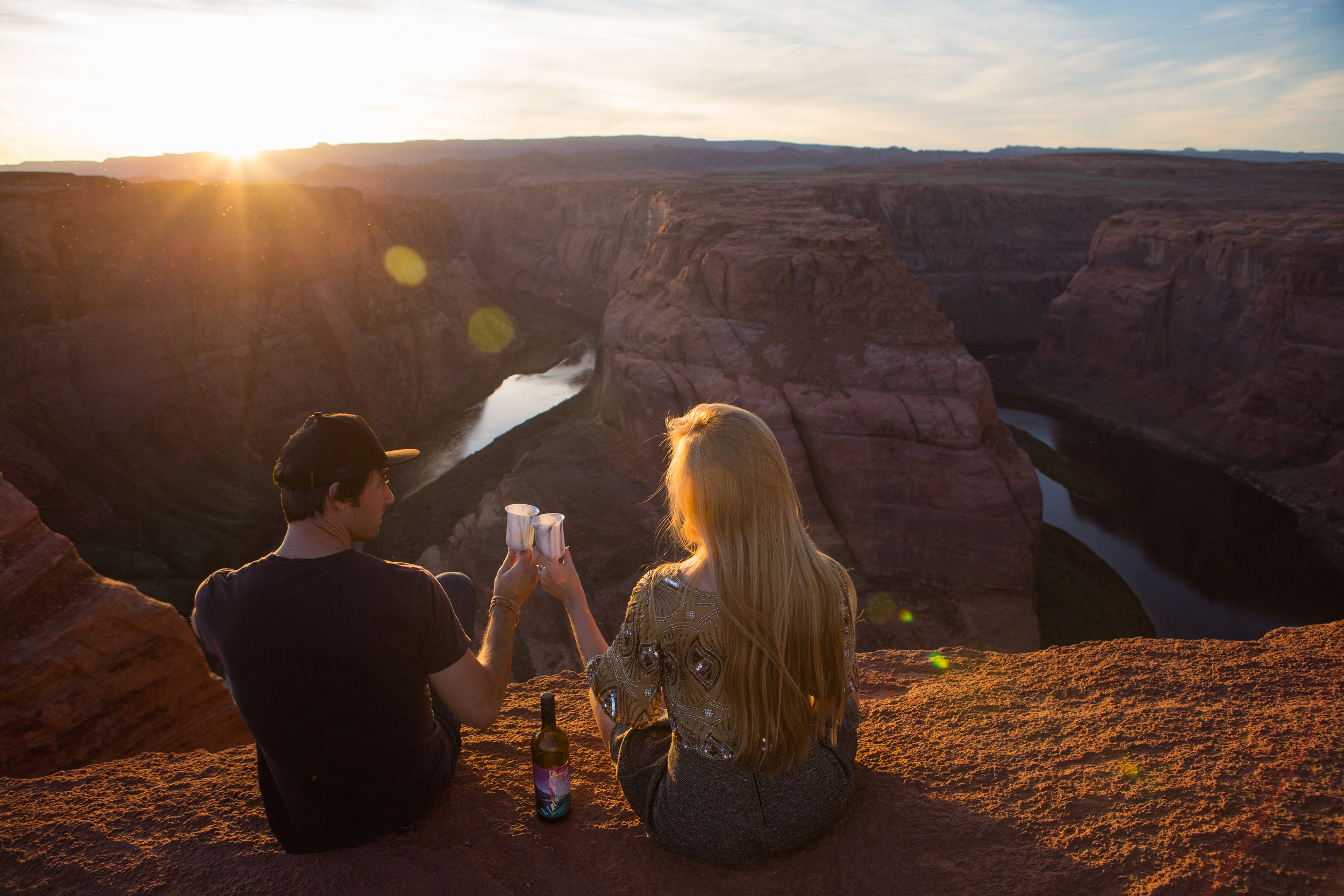 AstroBandit_JordanRose_DariusTwin_DarrenPearon_HorseshoeBend_Cheers_Sunset_Arizona_Wanderlust_Travel_Couple_Love.jpg