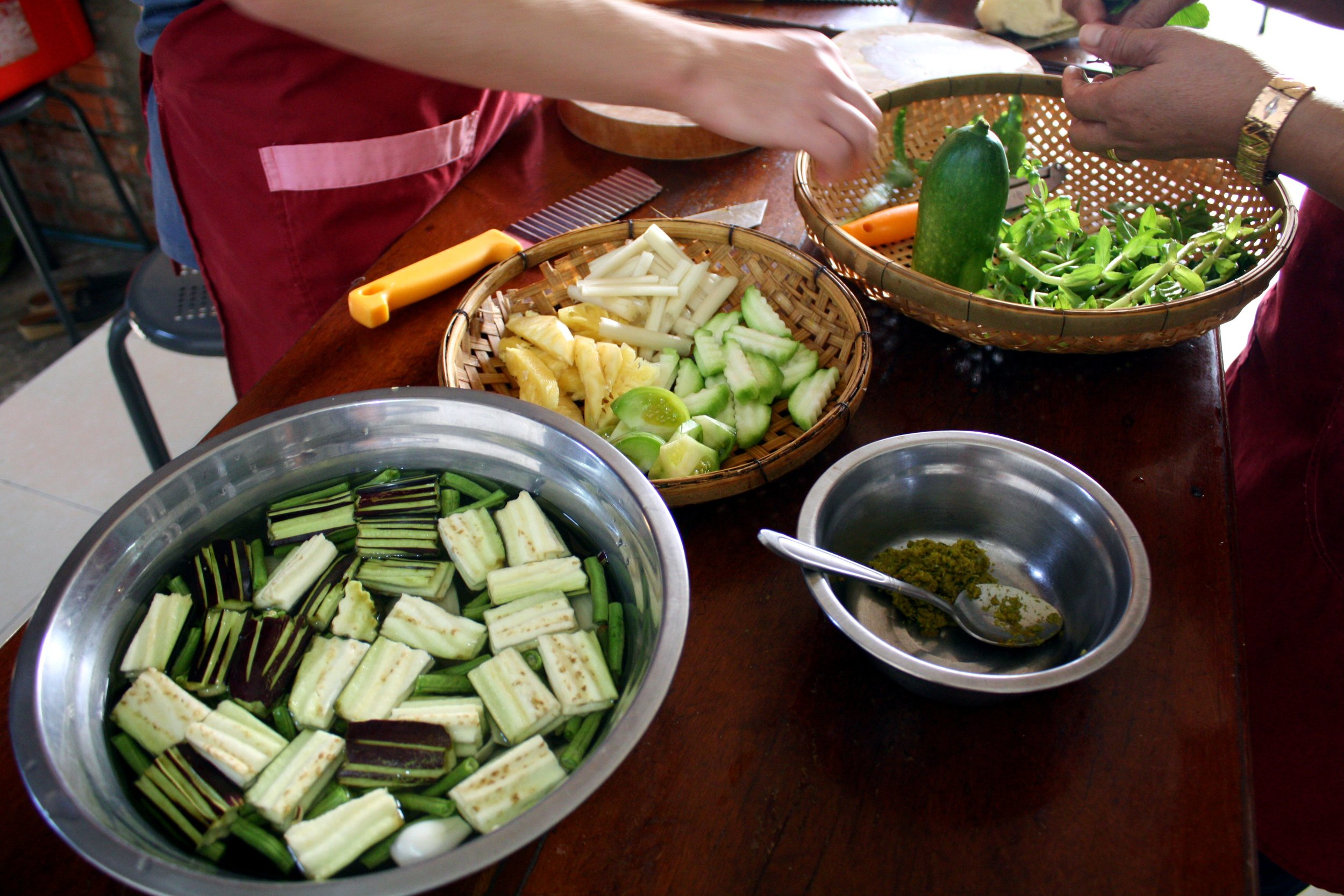 Prep for our green curry and sour fish soup.