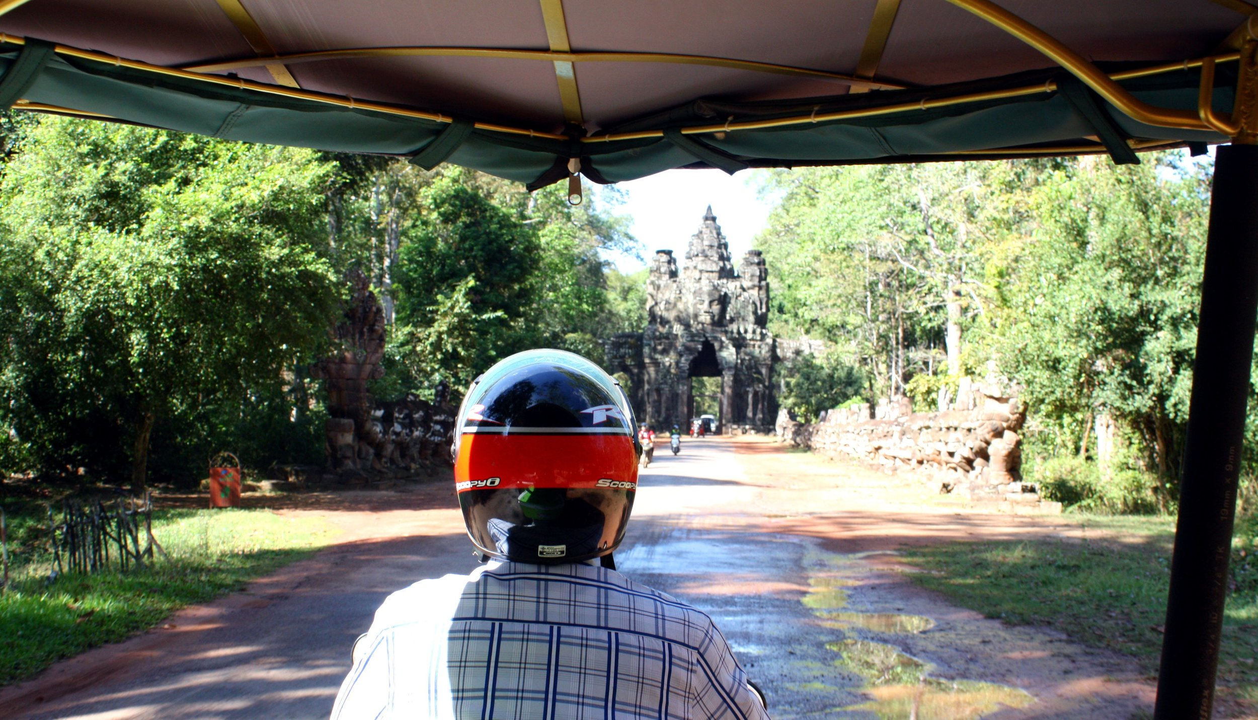Riding in our tuk tuk through Angkor Wat.