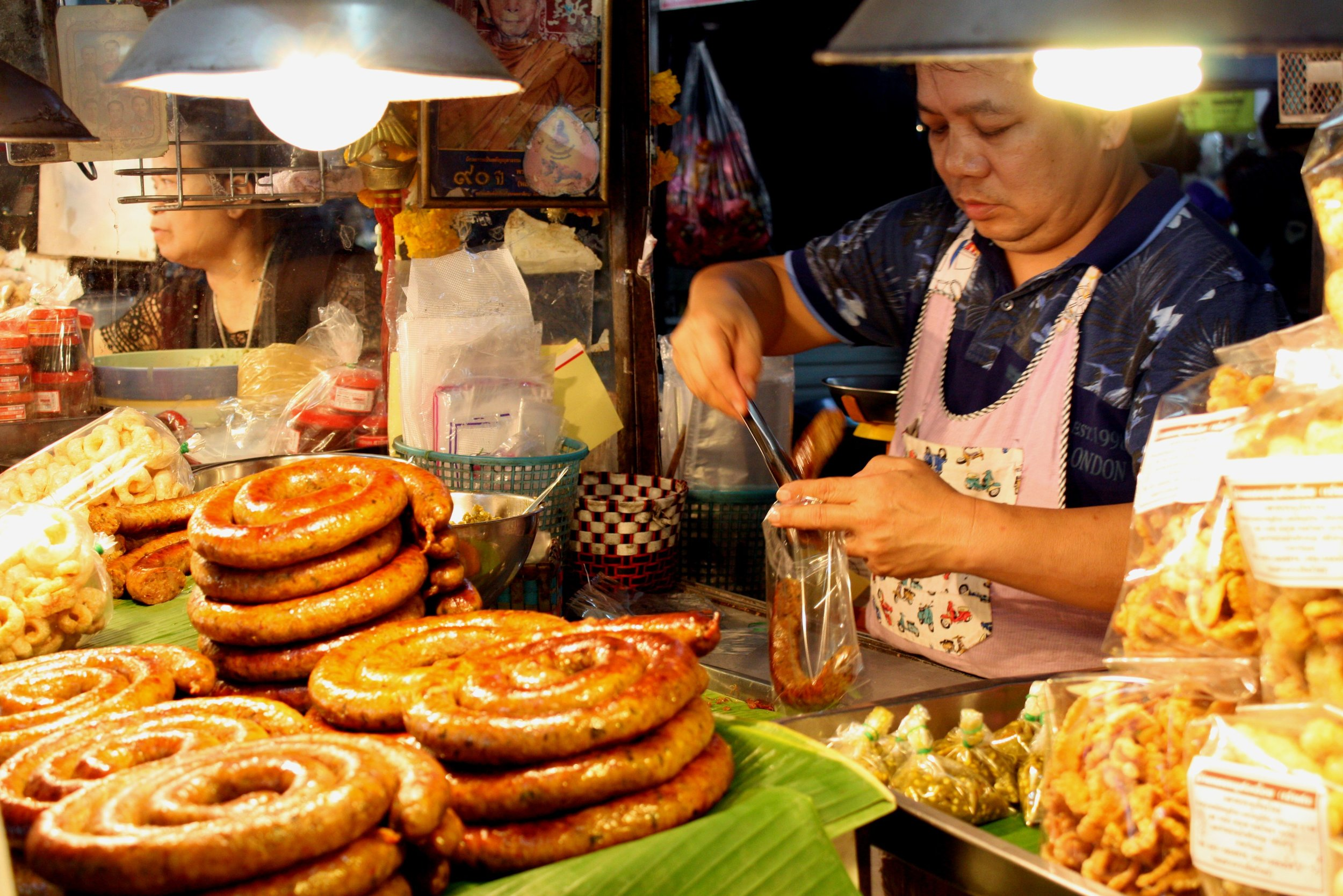 Sai Ua (Chiang Mai Sausage) are flavoured with lemongrass, kaffir lime leaves, galangal, turmeric and chilies.