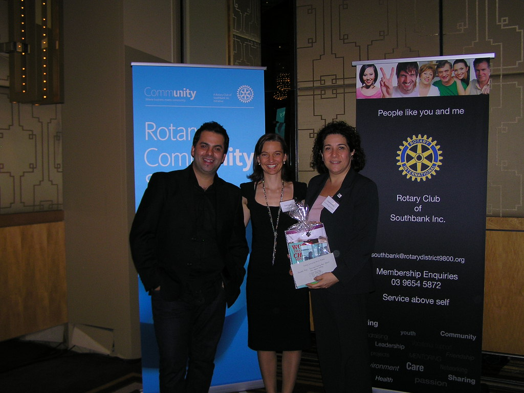Anneli presenting her prize to Deaf Children Australia