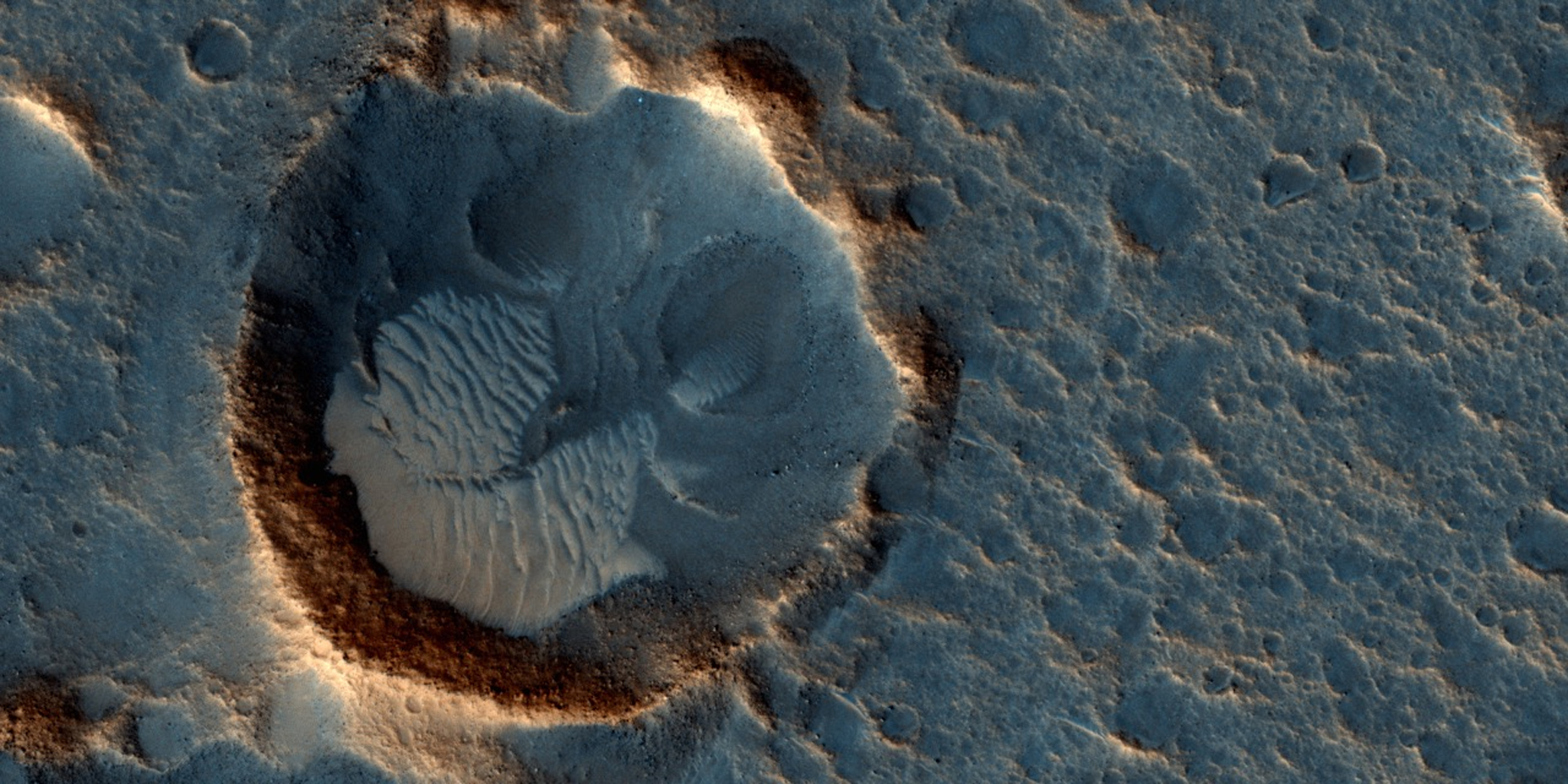 """This May 2015 image from the HiRISE camera on NASA's Mars Reconnaissance Orbiter shows a location on Mars associated with the best-selling novel and Hollywood movie, """"The Martian."""" Image credit: NASA/JPL-Caltech/Univ. of Arizona"""