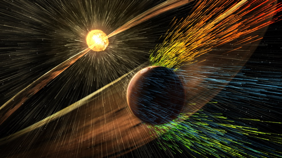Artist's rendering of a solar storm hitting Mars and stripping ions from the planet's upper atmosphere - Image Credit: NASA/GSFC