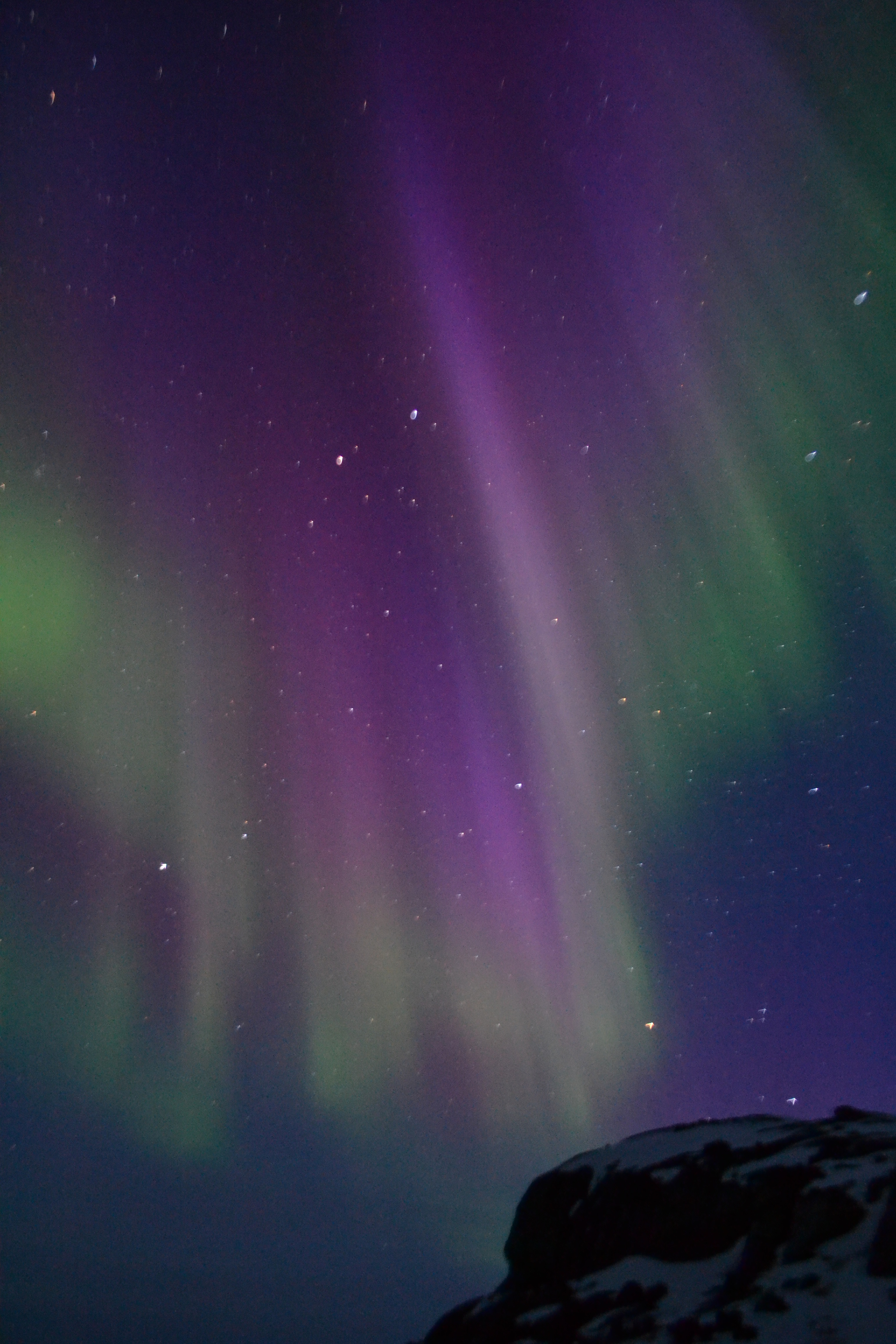 An aurora is seen over Greenland on April 2, 2011. Two NASA sounding rockets will launch into a particular type of aurora called a cusp aurora this winter to study different processes related to the particle acceleration that causes cusp auroras. The cusp is a region near the North Pole where Earth's magnetic field is directly connected to the solar wind, allowing daytime auroras to form. - Image credit: NASA/University of Maryland, College Park/Robert Michell