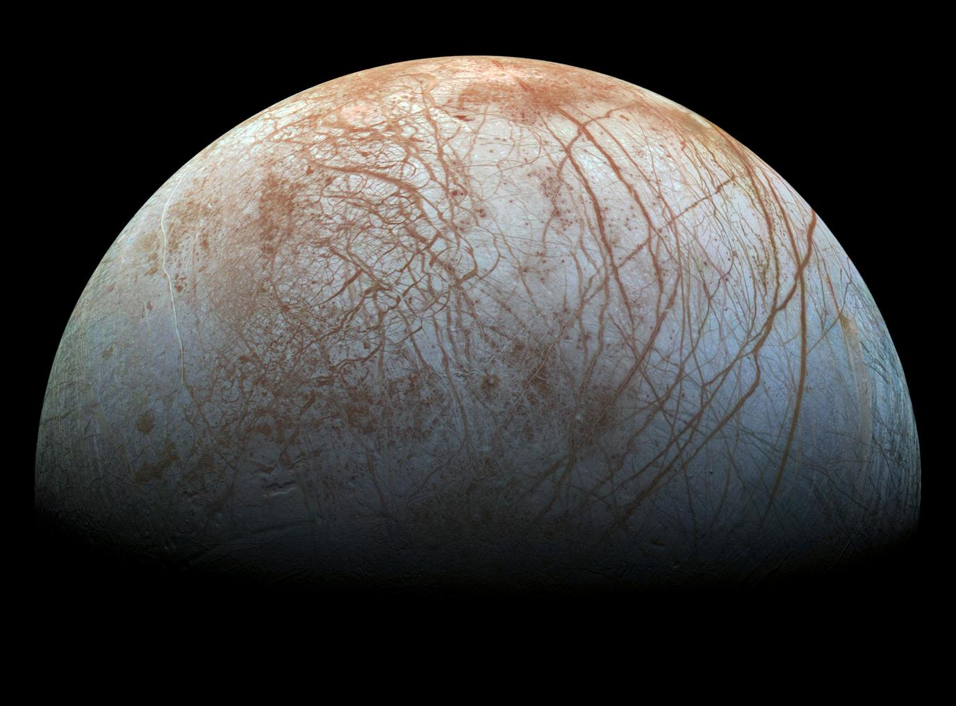 Europa, a 3130 km diameter moon of Jupiter. There is almost certainly a global ocean of salty water between the surface ice and the rocky interior.  - Image Credit:  NASA/JPL-Caltech/SETI Institute