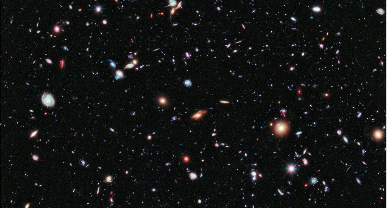 How do we think about something we can't see and don't experience in our everyday lives, but seems to be pushing our universe apart ever faster? – Image Credit: NASA, ESA