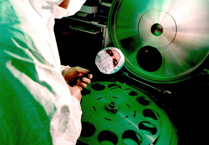 Adrian Cansell loading a 100mm silicon wafer into a 200 kV ion implanter.– Image Credit:  University of Surrey Ion Beam Centre   ,    Author provided