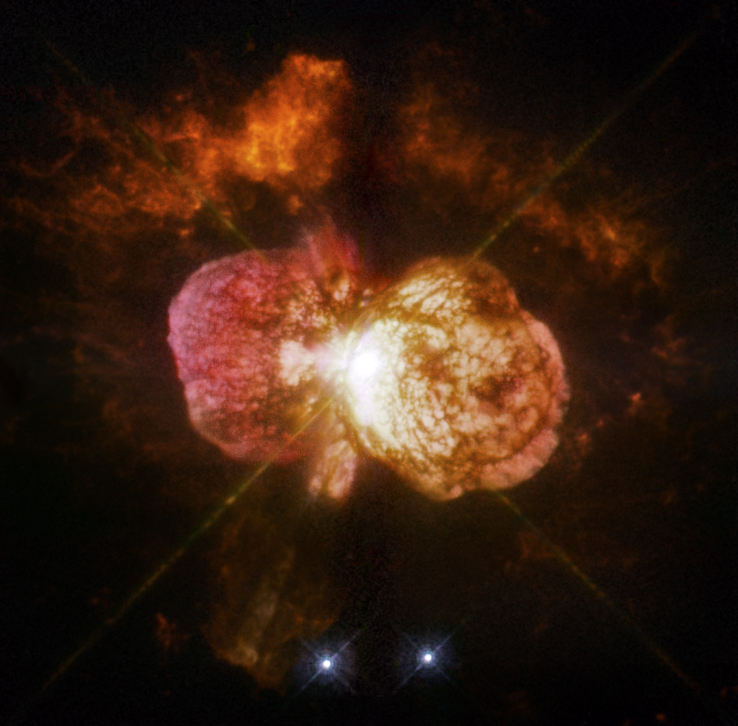 Eta Carinae's great eruption in the 1840s created the billowing Homunculus Nebula, imaged here by Hubble, and transformed the binary into a unique object in our galaxy. Astronomers cannot yet explain what caused this eruption. The discovery of likely Eta Carinae twins in other galaxies will help scientists better understand this brief phase in the life of a massive star. - Image Credits: NASA, ESA, and the Hubble SM4 ERO Team