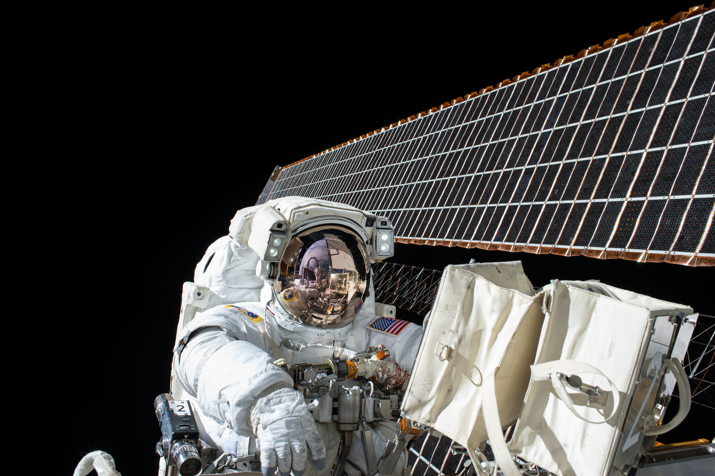 Nice night for a stroll: Scott Kelly working outside the International Space Station in 2015. - Image Credit: NASA