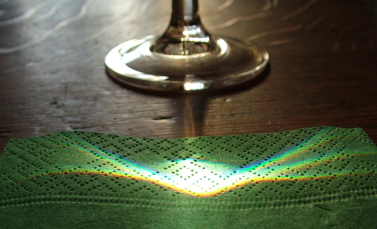 Note the differing colours from the light through the wineglass - Image Credit:  anataman/flickr