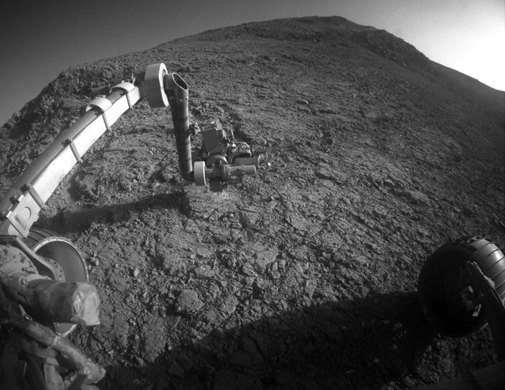 """The target beneath the tool turret at the end of the rover's robotic arm in this image from NASA's Mars Exploration Rover Opportunity is """"Private John Potts."""" It lies high on the southern side of """"Marathon Valley,"""" which slices through the western rim of Endeavour Crater. – Image Credit: NASA/JPL-Caltech"""