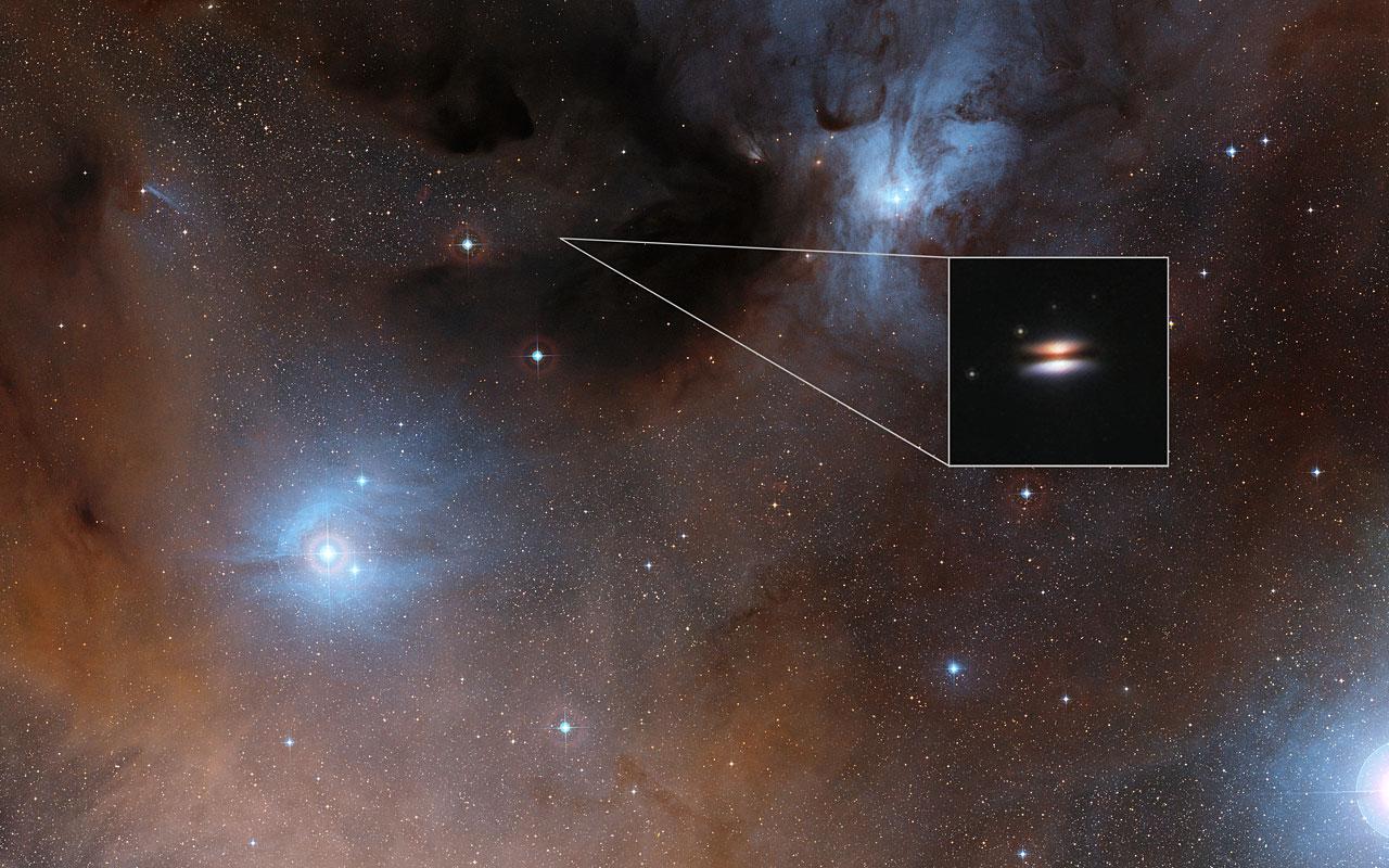 The Flying Saucer protoplanetary disc around 2MASS J16281370-2431391 - Image Credit:  Digitized Sky Survey 2/NASA/ESA
