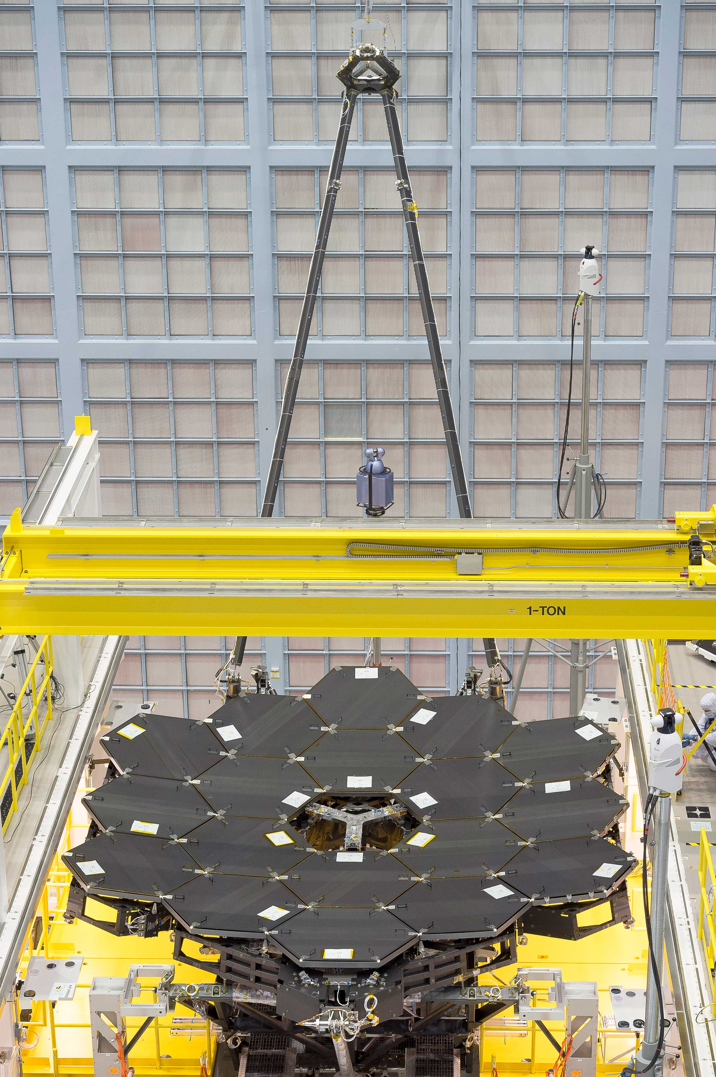 In this rare view, the James Webb Space Telescope's 18 mirrors are seen fully installed on the James Webb Space Telescope structure at NASA's Goddard Space Flight Center in Greenbelt, Maryland. - Image   Credits: NASA/Chris Gunn