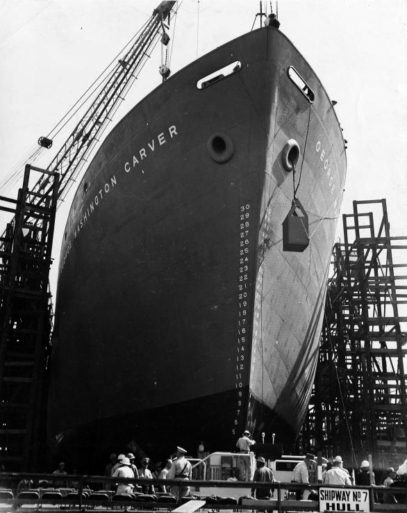"A Liberty ship, SS George Washington Carver, launches in 1943. By 1944, wartime production of these ""ugly duckling"" cargo steamers took an average of 42 days. - Image   Credits: E.F. Joseph/The New York Public Library/Photographs and Prints Division"