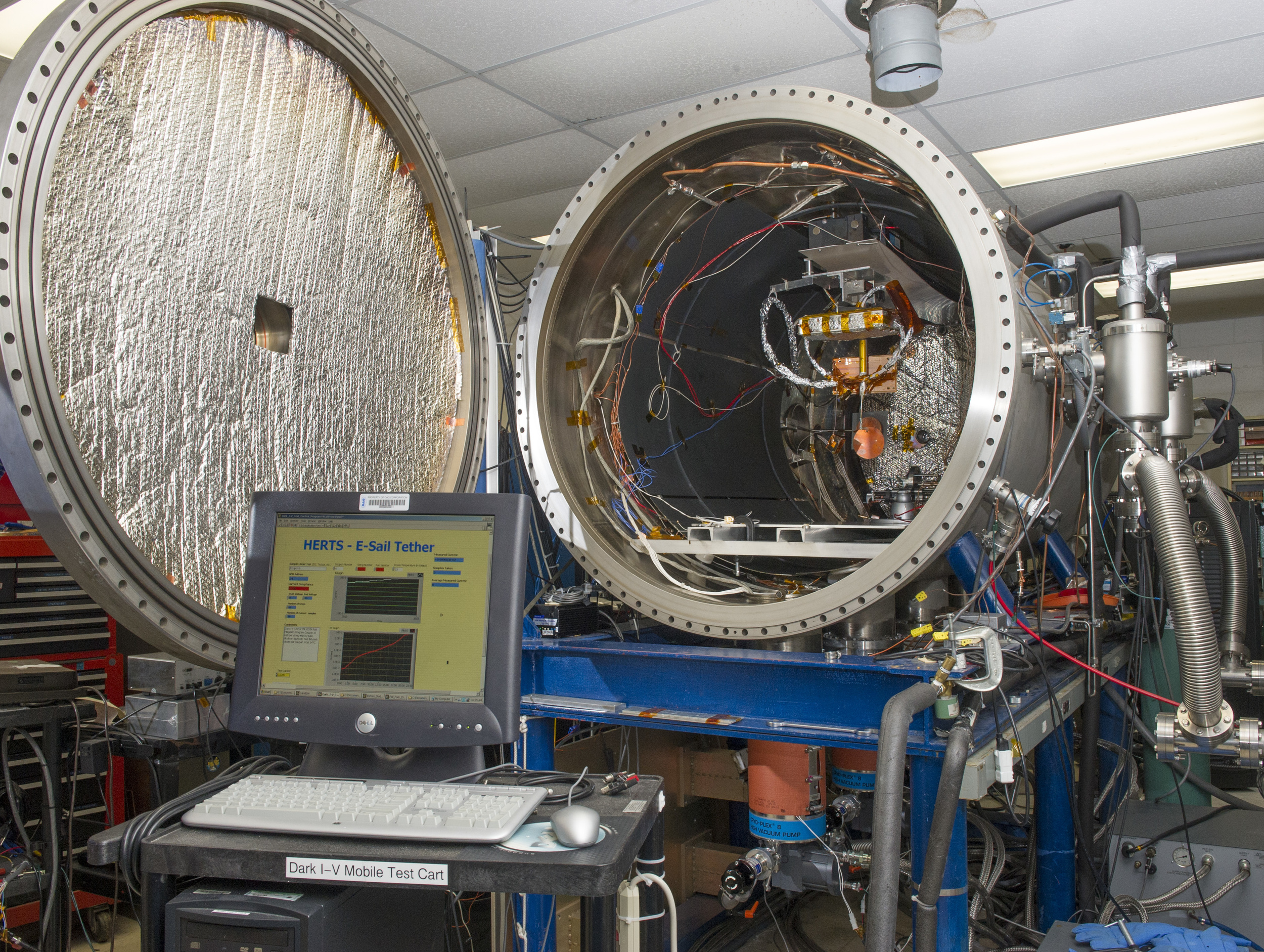 Within a controlled plasma chamber -- the High Intensity Solar Environment Test system -- tests will examine the rate of proton and electron collisions with a positively charged tether. Results will help improve modeling data that will be applied to future development of E-Sail technology concept. - Image Credits: NASA/MSFC/Emmett Given
