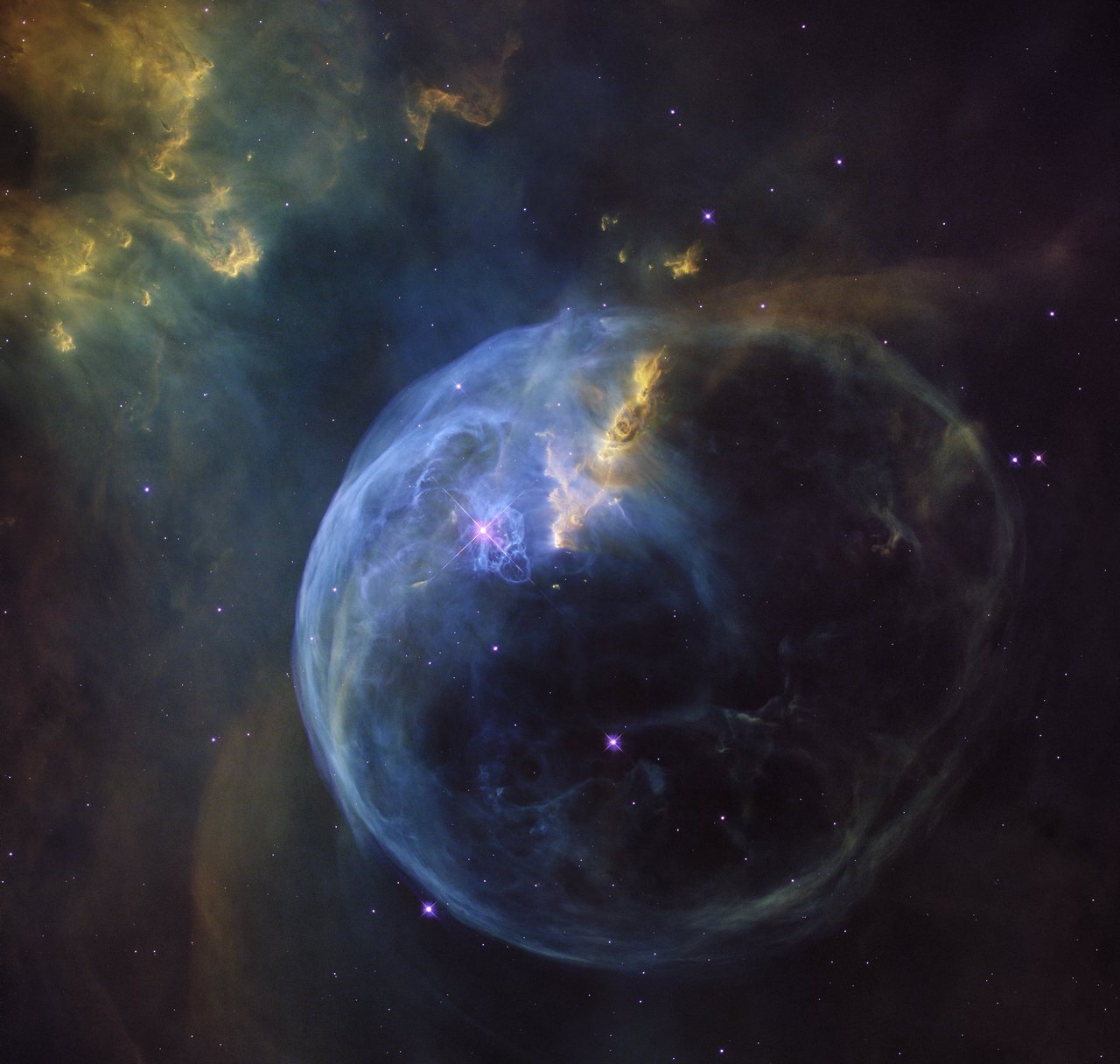 The Bubble Nebula, also known as NGC 7653, is an emission nebula located 8 000 light-years away. This stunning new image was observed by the NASA/ESA Hubble Space Telescope to celebrate its 26th year in space. – Image Credit: NASA, ESA, Hubble Heritage Team