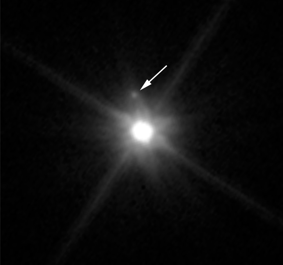 This Hubble image reveals the first moon ever discovered around the dwarf planet Makemake. The tiny satellite, located just above Makemake in this image, is barely visible because it is almost lost in the glare of the very bright dwarf planet. Hubble's sharp-eyed WFC3 made the observation in April 2015. - Image   Credits: NASA, ESA, and A. Parker and M. Buie (SwRI)