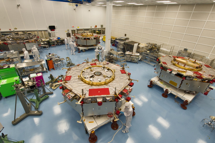 The four spacecraft of the MMS mission getting prepared for stacking operations. - Image Credit: NASA/Flickr , CC BY-SA