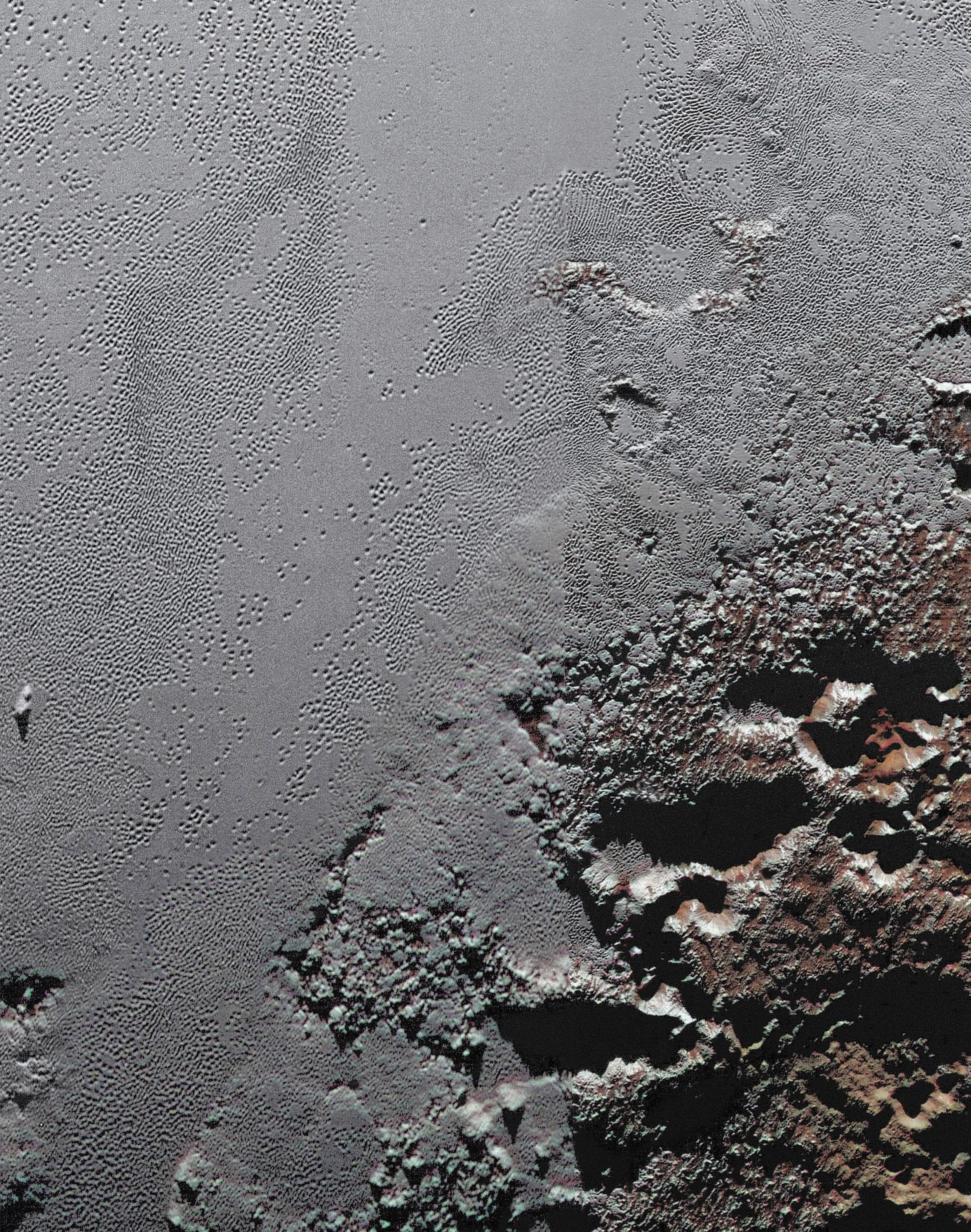 This dramatic image from NASA's New Horizons spacecraft shows the dark, rugged highlands known as Krun Macula (lower right), which border a section of Pluto's icy plains. Click on the image and zoom in for maximum detail. - Image   Credits: NASA/JHUAPL/SwR