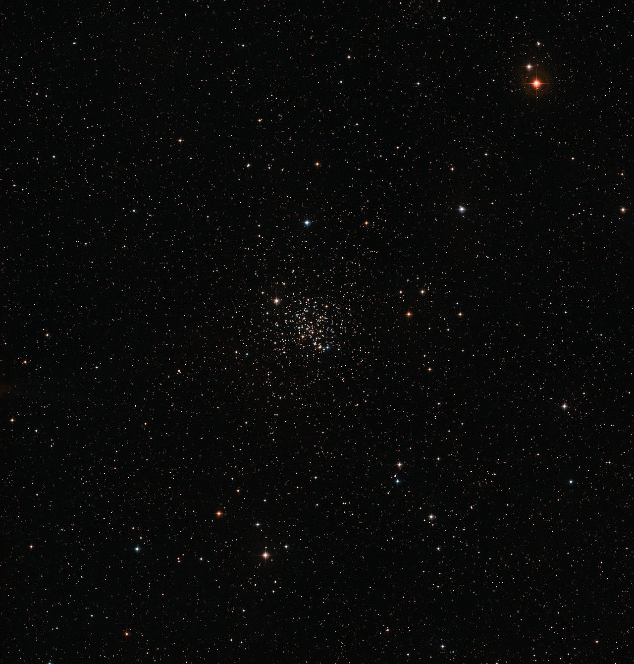 This wide-field image of the sky around the old open star cluster Messier 67 was created from images forming part of the Digitized Sky Survey 2. The cluster appears as a rich grouping of stars at the centre of the picture. Messier 67 contains stars that are all about the same age, and have the same chemical composition, as the Sun. – Image Credit: ESO/Digitized Sky Survey 2 - Acknowledgement: Davide De Martin