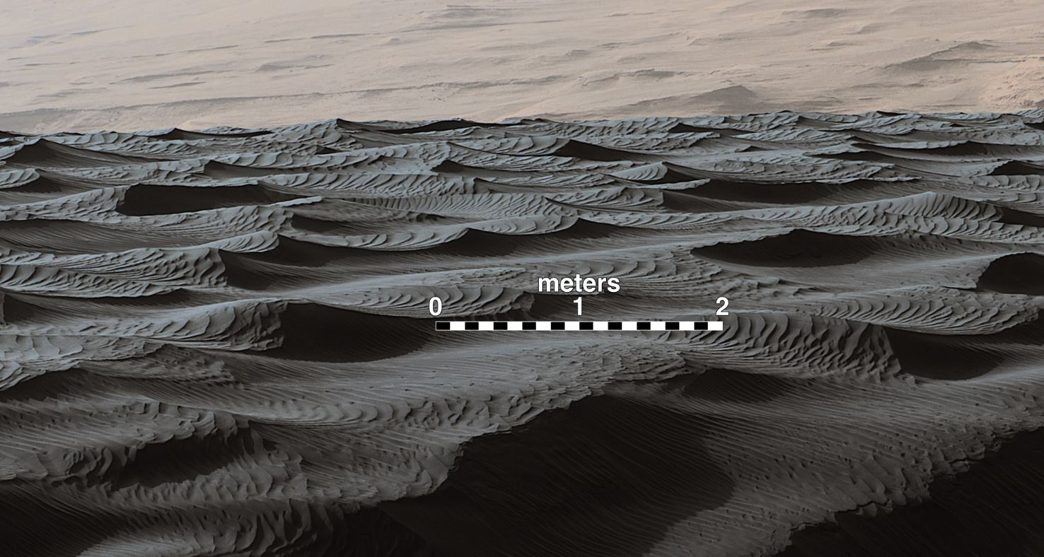 Two sizes of ripples are evident in this Dec. 13, 2015, view of a top of a Martian sand dune, from NASA's Curiosity Mars rover. Sand dunes and the smaller type of ripples also exist on Earth. The larger ripples are a type not seen on Earth nor previously recognized as a distinct type on Mars. – Image Credits: NASA/JPL-Caltech/MSSS