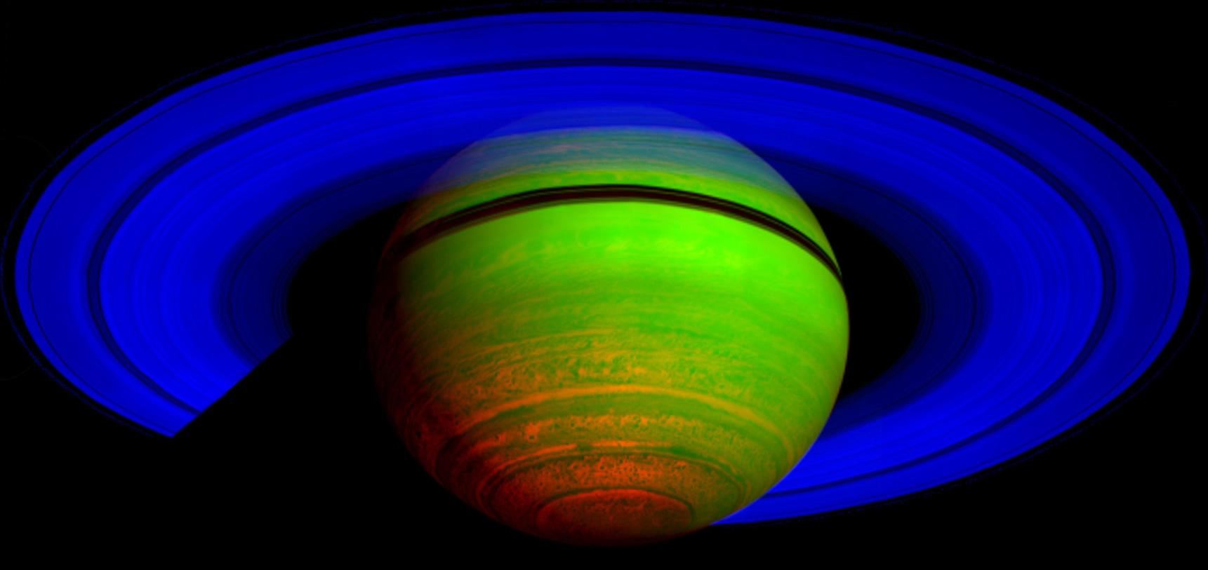 Saturn by NASA's Cassini orbiter. This is a false colour image recorded using three infrared wavelengths, and shows patterns of thermal emission rather than reflected sunlight. – Image Credit:  NASA/JPL/ASI/University of Arizona