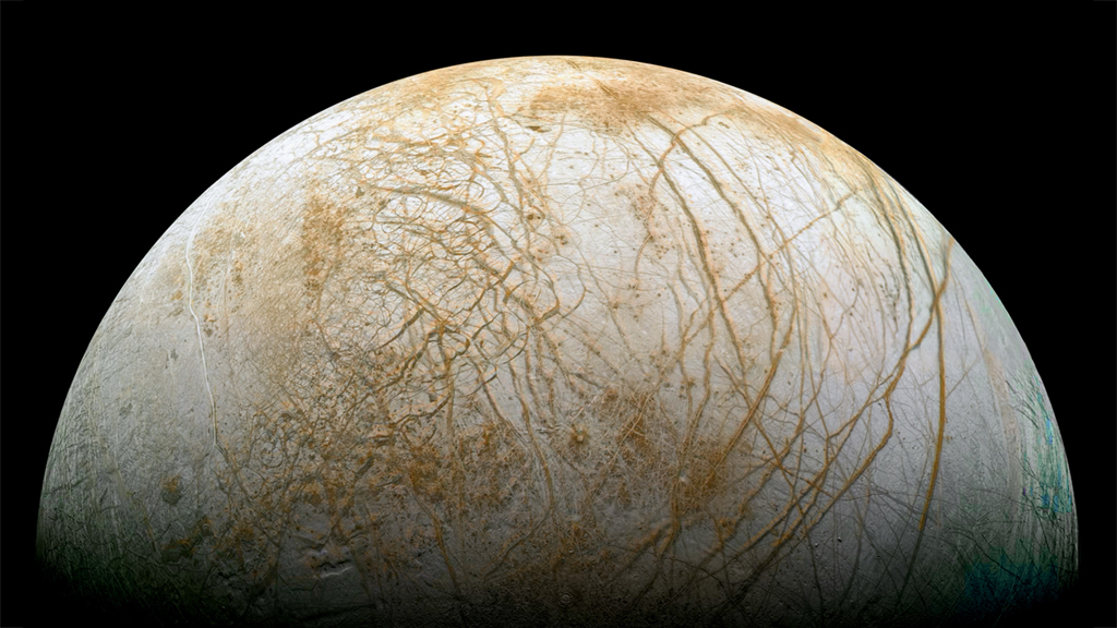 The prize, Europa, a watery world. - Image Credit: NASA