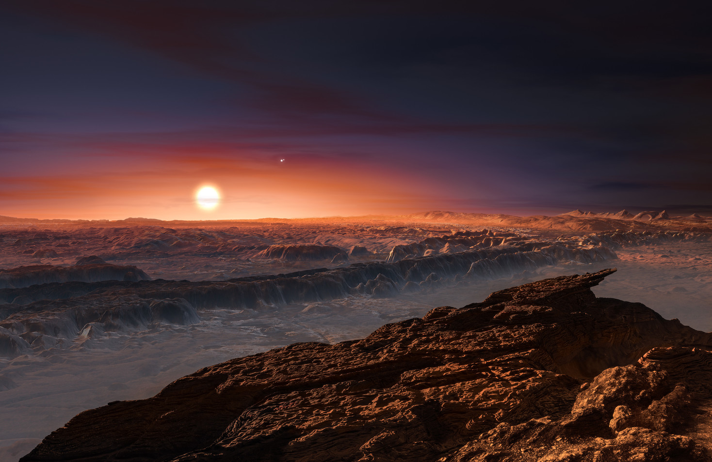 An artist's impression shows a view of the surface of the planet Proxima b orbiting the red dwarf star Proxima Centauri. The double star Alpha Centauri AB appears to the upper-right of Proxima itself. – Image Credit: ESO/M. Kornmesser