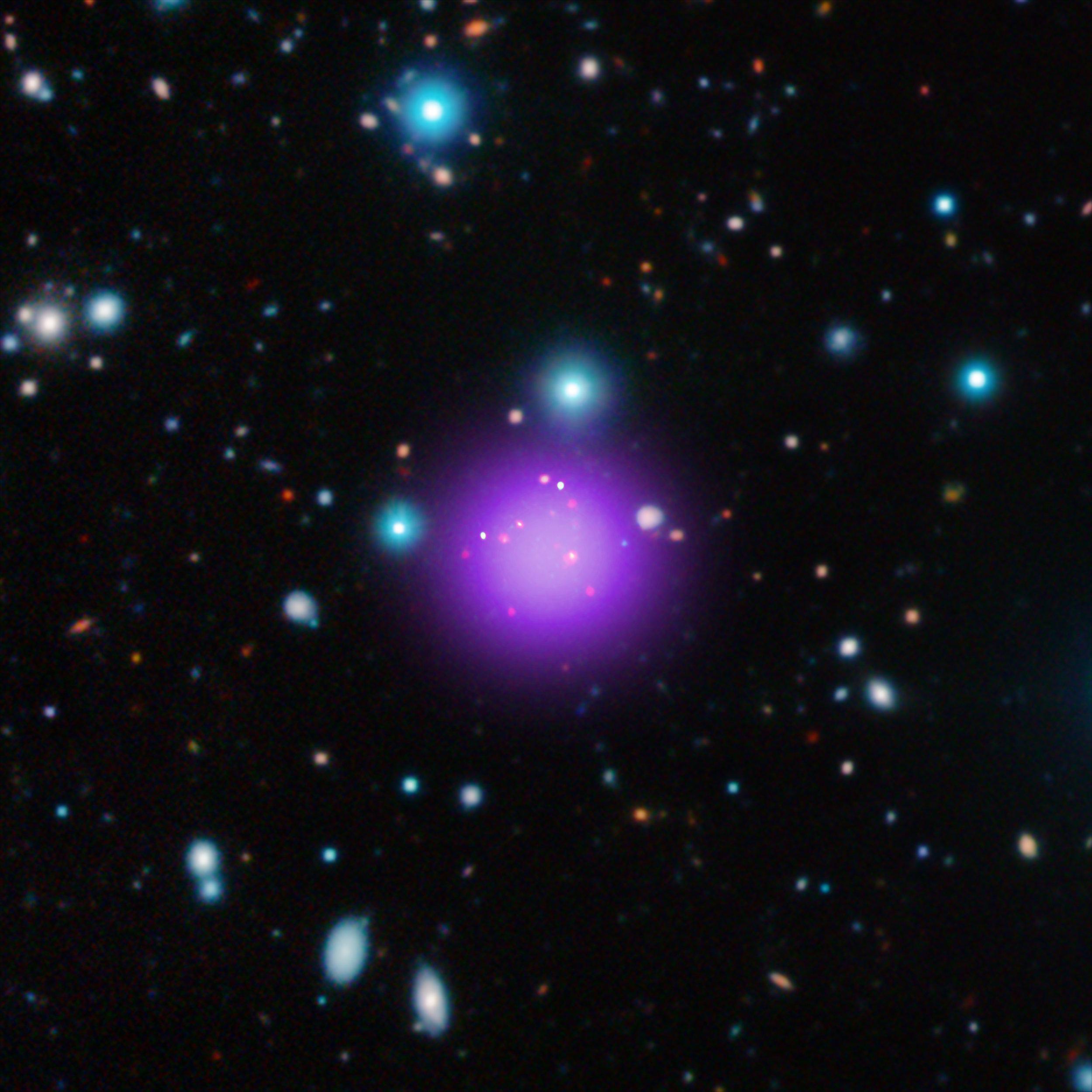 Galaxy Cluster CL J1001+0220 - Image   Credits: X-ray: NASA/CXC/CEA/T. Wang et al; Infrared: ESO/UltraVISTA; Radio: ESO/NAOJ/NRAO/ALMA