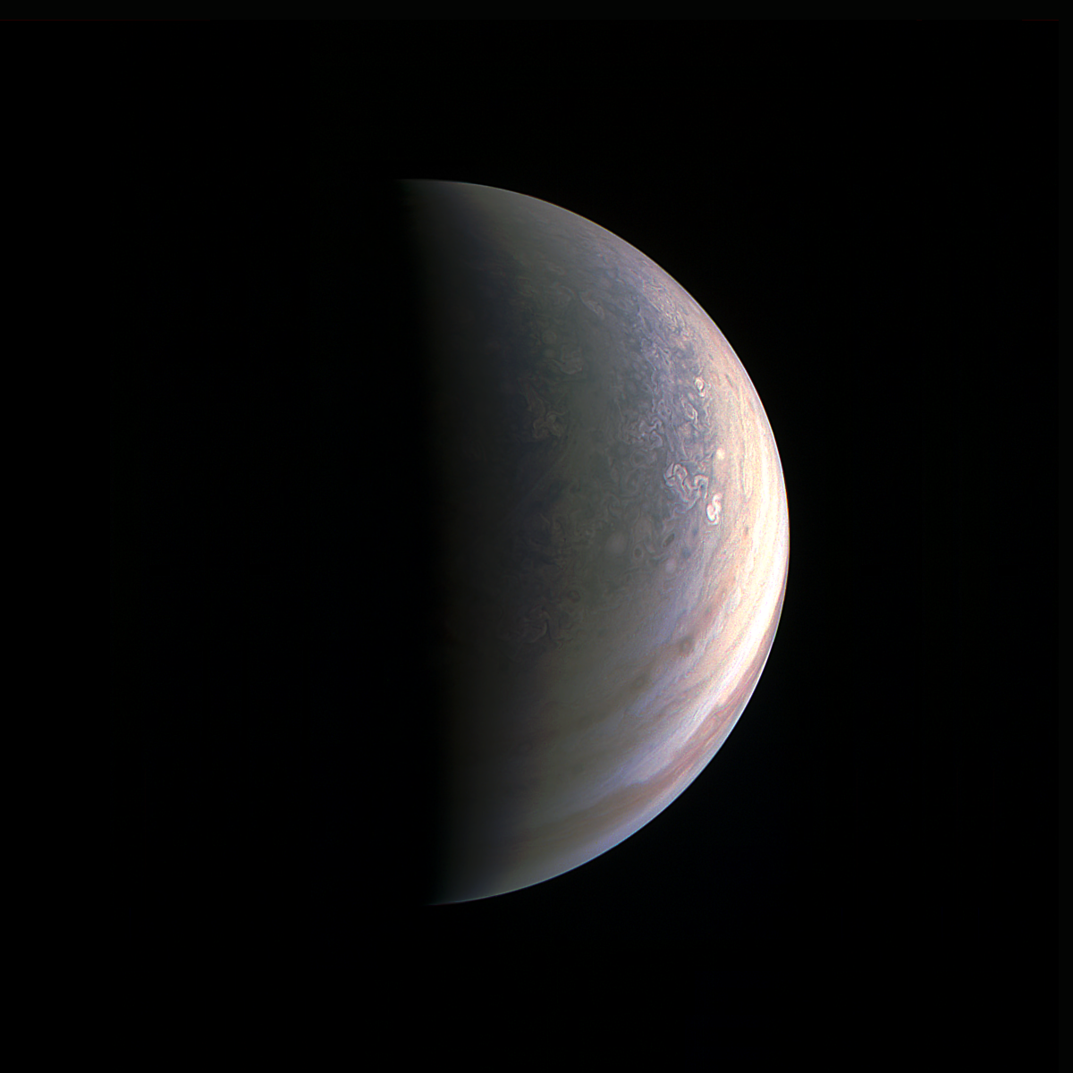 NASA's Juno spacecraft captured this view as it closed in on Jupiter's north pole, about two hours before closest approach on Aug. 27, 2016. - Image   Credits: NASA/JPL-Caltech/SwRI/MSSS