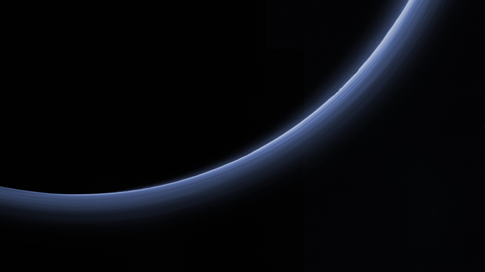 Pluto's hazy atmosphere, made visible by scattered sunlight seen by New Horizons. - Image Credit: NASA/Johns Hopkins University Applied Physics Laboratory/Southwest Research Institute