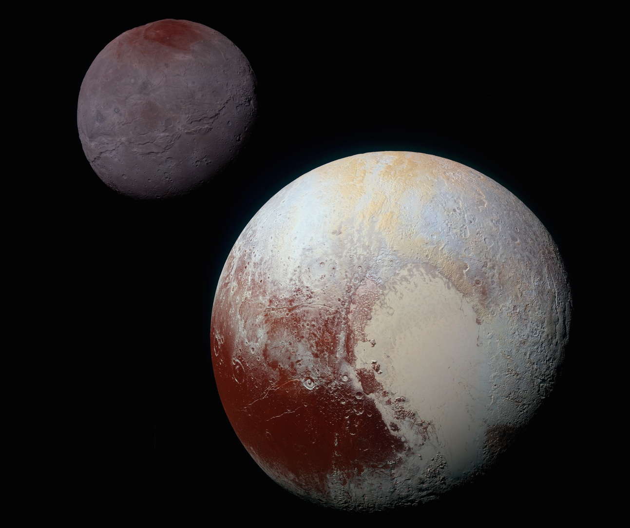 Charon (left) and Pluto (right) at the same scale. Charon is 1,212 km in diameter, Pluto 2,370 km. - Image Credit: NASA/Johns Hopkins University Applied Physics Laboratory/Southwest Research Institute