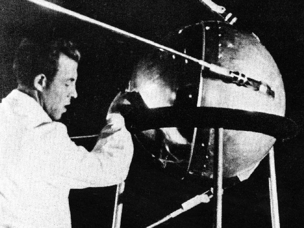 Photograph of a Russian technician putting the finishing touches on Sputnik 1, humanity's first artificial satellite. - Image Credit: NASA/Asif A.
