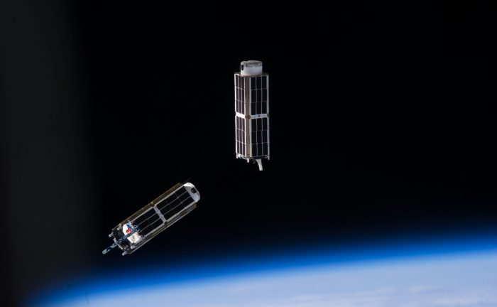 NanoRacks CubeSats photographed after deployment from the ISS by an Expedition 38 crew member. - Image Credit: NASA