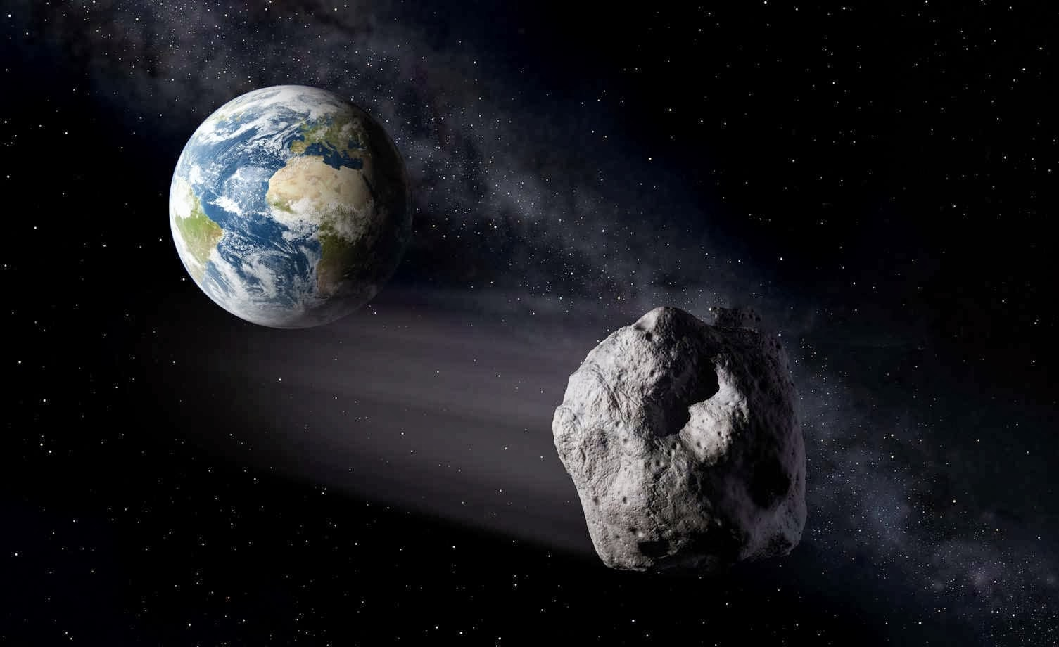 Artist's impression of a Near-Earth Asteroid passing by Earth. - Image Credit: ESA