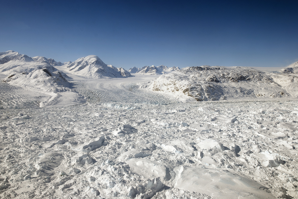 Floating ice at the calving front of Greenland's Kangerdlugssuaq glacier, photographed in 2011 during Operation IceBridge. - Image Credit: NASA/Michael Studinger