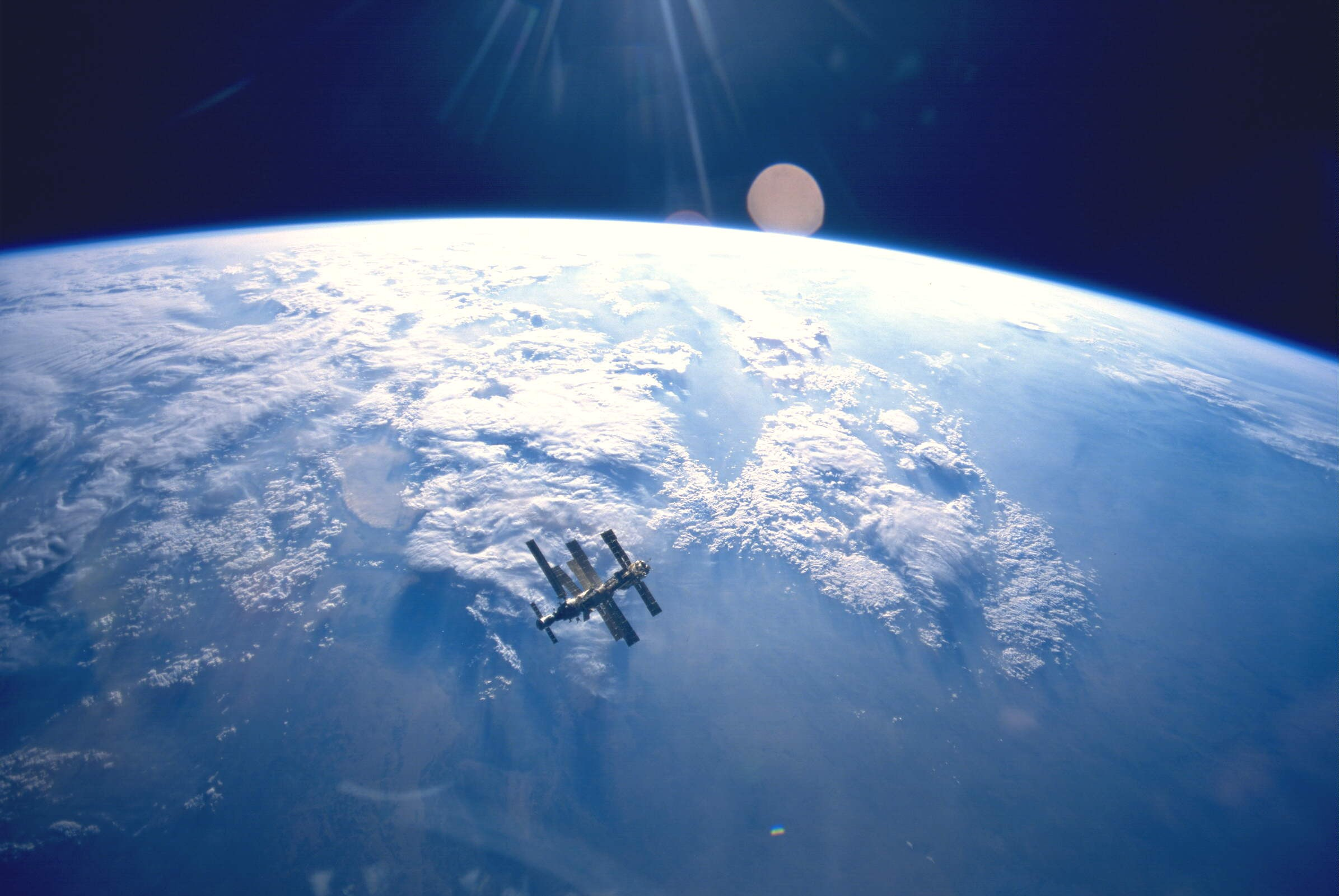 The Mir space station hangs above the Earth in 1995 (photo taken by the mission crew of the Space Shuttle Atlantis, STS-71) - Image Credit: NASA