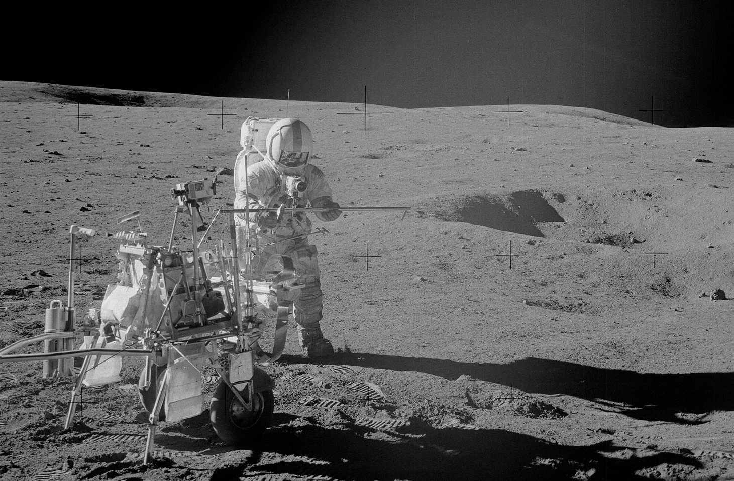 Apollo 14 astronaut Al Bean collects samples in the region where the evidence of very early lunar crust formation comes from. - Image Credit: NASA, AS14-68-9405