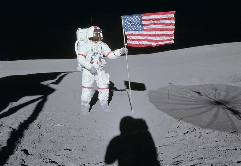 Astronaut Alan Shepard poses next to the American flag on the Moon during the Apollo 14 mission. - Image Credit: NASA