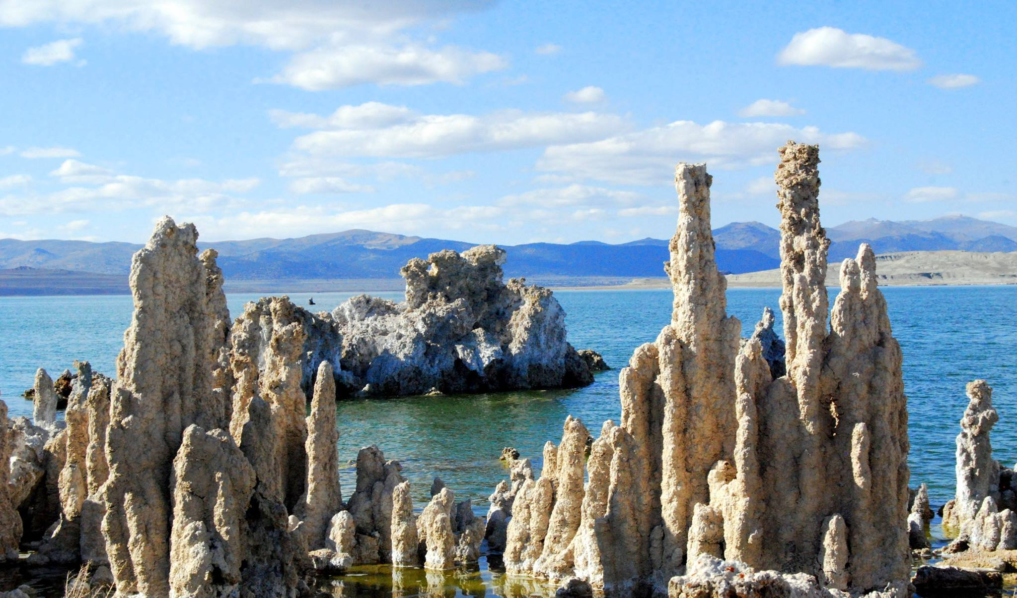 """Mono Lake, California, with salt pillars known as """"tufas"""" visible. JPL scientists tested new methods for detecting chemical signatures of life in the salty waters here, believing them to be analogs for water on Mars or ocean worlds like Europa. – Image Credits: Mono County Tourism"""
